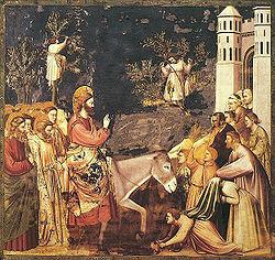 Jesus rider in i Jerusalem på en åsna på palmsöndagen. Fresk av Giotto