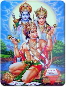 Apguden Hanuman. I bakgrunden guden Rama med gemålen Sita, med vars öden Hanuman är förknippad. Detta skildras i eposet Ramayana. Kungakronan och spiran symboliserar kraft och mod.